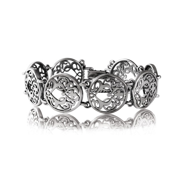Серебристый бижутерный браслет с узорами